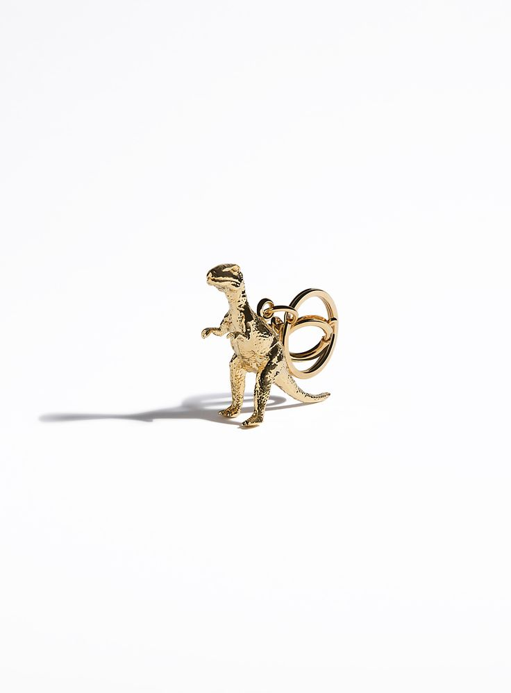 Our dinosaur charm is a gold-plated replica of a toy dinosaur. As well as a playful addition to your tote, he makes for great child's play. Beautiful design with a playful edge.