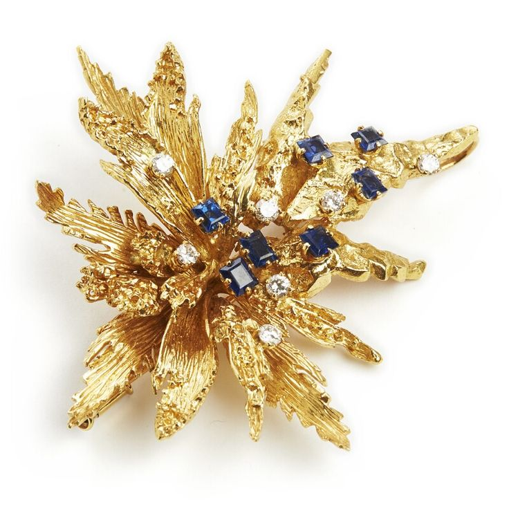CHAUMET: A sapphire and diamond brooch set with numerous square-cut sapphires and brilliant-cut diamonds, mounted in 18k gold. App. 6.5 x 6.0 cm. Weight app. 32 g. Circa 1960-70.