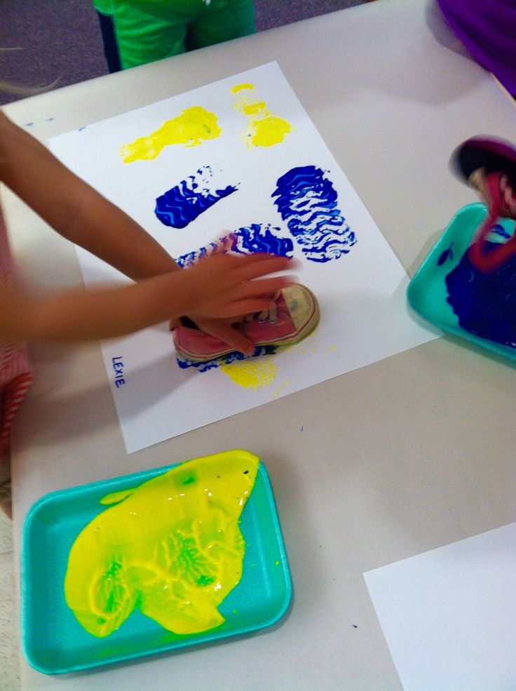 Nursery Rhymes. There Was An Old Woman Who Lived In A Shoe. Painting with shoes.