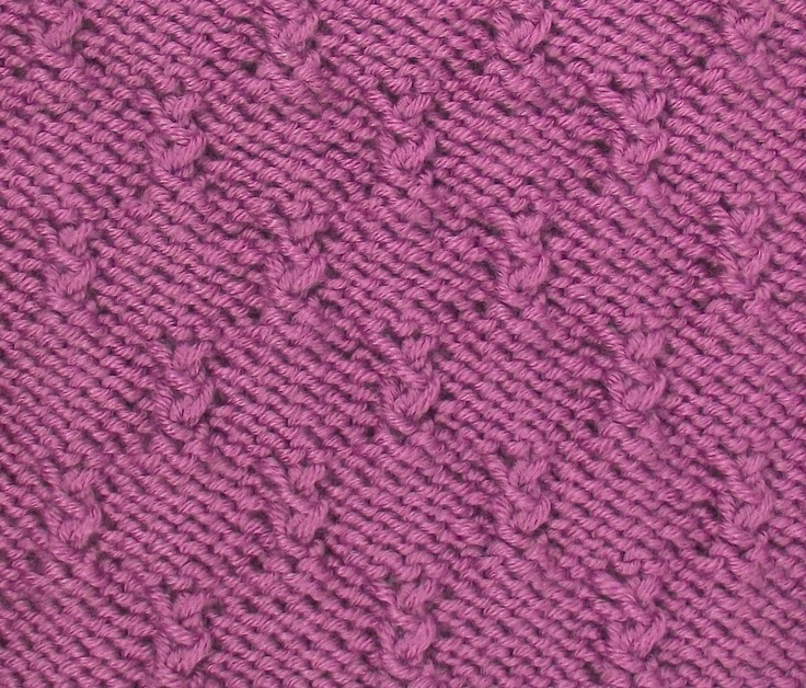 Alternating Grass Tufts is a great all over textured stitch based on reverse stocknette.  This knitting stitch is found in the Bobbles & Slip Stitches category.
