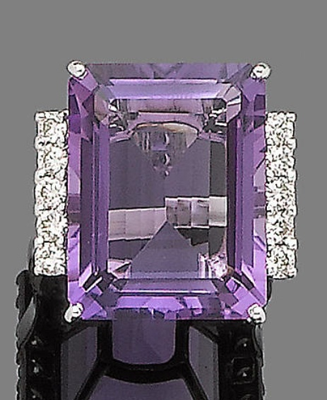 An amethyst and diamond dress ring The rectangular step-cut amethyst between brilliant-cut diamond shoulders, to an 18 carat white gold band, diamonds approx. 0.35ct total, London hallmark