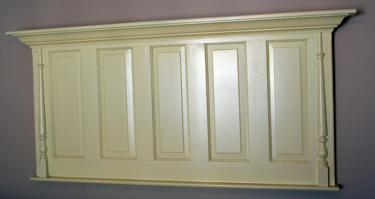 Headboard made from an old door with spindel decoration