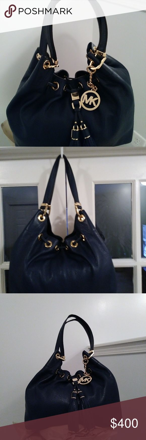MICHAEL KORS NAVY BLUE CAMDEN DRAWSTRING PURSE *W/ MICHAEL KORS NAVY BLUE CAMDEN DRAWSTRING PURSE *W/WALLET* BUNDLE  Used about 5 times Magnetic clasp. Still has paper in some pockets.  Original Price with Wallet $520  Yours TODAY for $375  WBAG and a Special Gift:) Michael Kors Bags Shoulder Bags