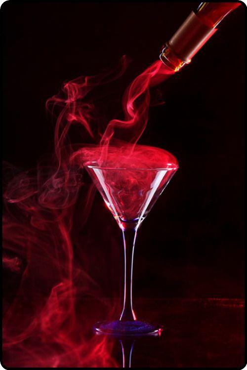 Smoky red martini on black background