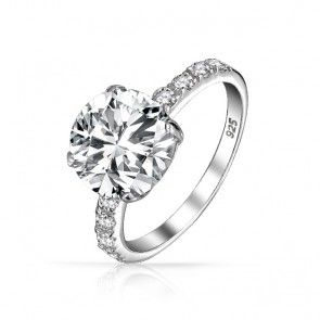 Beautiful and simple 2ct round diamond engagement ring with diamond band. It's absolutely perfect.