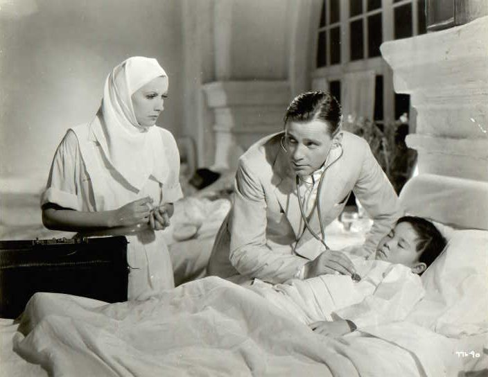 The Painted Veil. Herbert Marshall as Walter fane Taking Care of a Sick Child, while his unfaithful wife Kitty (greta garbo) is watching. Good Adaption of Somerset maughams Great Nobel