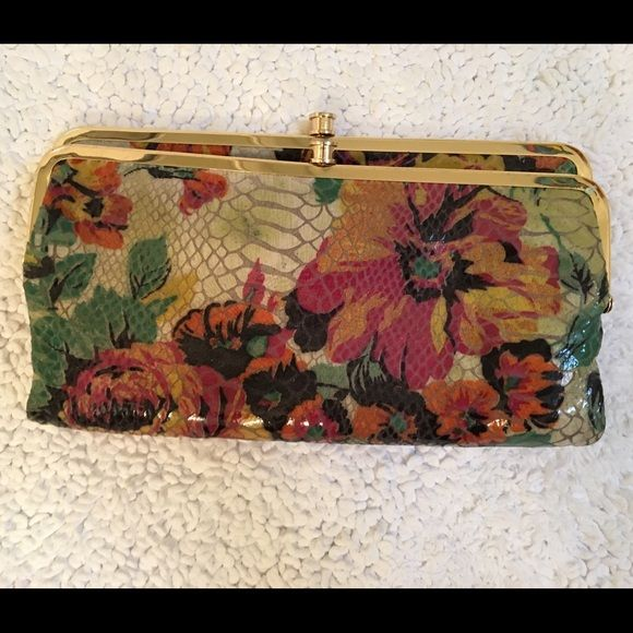 Hobo wallet Gently used, hobo wallet. Floral print with several pouches for storage. Great condition. HOBO Bags Wallets