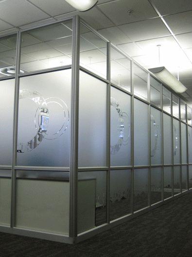 Graphic decal on panels: Cut sandblast vinyl decal. #officespace #interiordesign