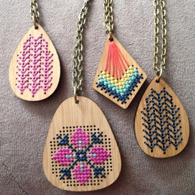 Cross stitched wooden pendants
