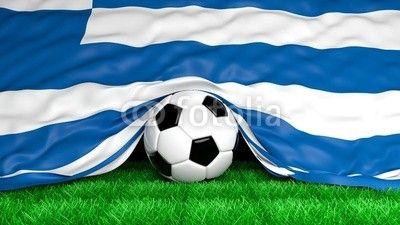 Soccer ball with Greek flag on football field closeup