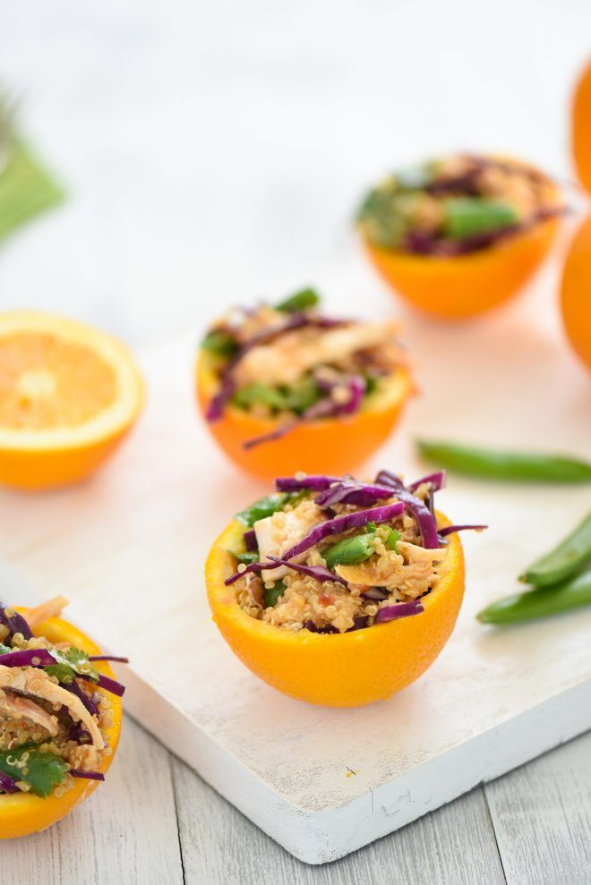 Asian Chicken Quinoa Salad in Orange Cups - Make healthy eating fun with this pretty presentation! Quinoa, pulled chicken and veggies are tossed with an Asian peanut dressing and served in Valencia orange cups. | foxeslovelemons.com