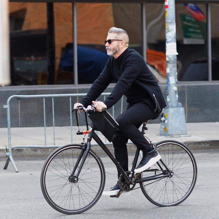 """""""Black and white and biking all over: stylist Garth Condit @garthcondit departing by bicycle at the menswear shows. Photo by @gastrochic #streetstyle…"""""""