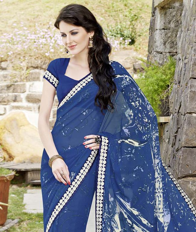 Shine more beautifully in all new ethnic avatar with fashionandyou.com as it brings to you a lavish collection of fabulous sarees. Exhibiting exquisite craftsmanship and amazing colours, the range is here to put in joy in your wardrobe. So flaunt it with style.BRAND: SeymoreCATEGORY: Saree with Unstitched BlouseARTICLECOLOURMATERIALLENGTHSareeBlueFaux Georgette 5.50 metersBlouseBlueCotton Blend0.80 meterWe would always want to send you what we showcase but there might be a slight variation…