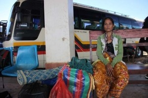 Road Travel In Laos. Local women looking thrilled..