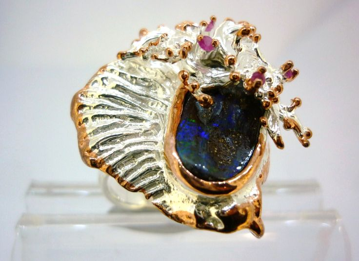 Queensland boulder Opal and rubies in a stirling silver ring with rose gold touches #silver #jewellery #ring #boulder_opal #opal