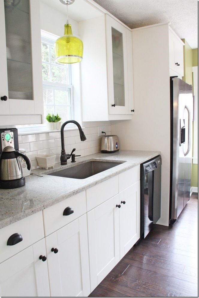 IKEA cabs with granite sink and oil rubbed bronze faucet,   cream subway tile and gray grout at southern hospitality blog