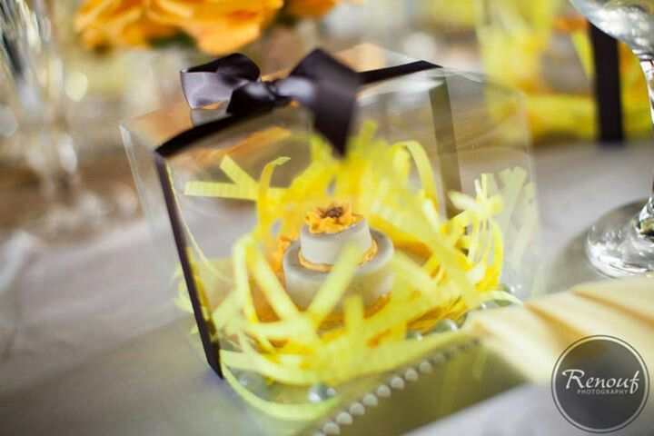 Favors: heart shaped sugar cookie underneath chocolate covered oreo wedding cakes. Yellow and gray theme