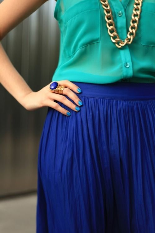 teal blouse cobalt blue skirt & gold chain necklace