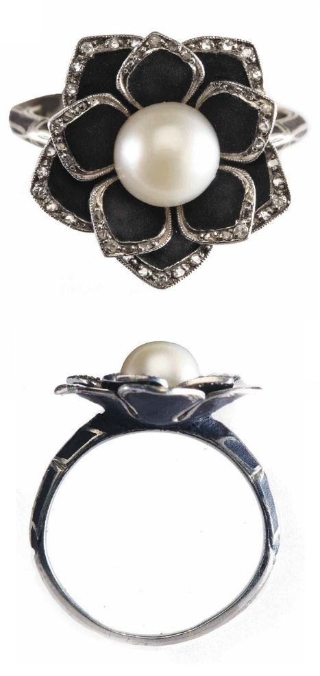 AN ART DECO PEARL, DIAMOND AND ENAMEL ''LOTUS'' RING, BY J. STELTMAN, CIRCA 1920. The lotus flower with black enamel leaves and rose-cut diamond borders centring a natural pearl measuring 7.2 mm. in diameter to black enamelled decorated shoulders. Makers mark for J. Steltman and Dutch marks for gold. #ArtDeco #Stelman #ring