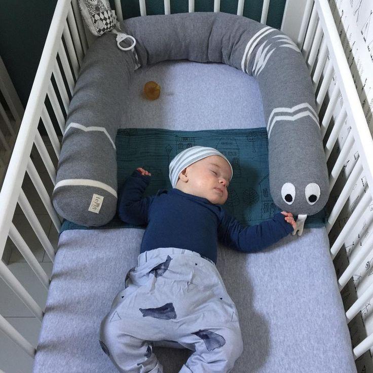 Mr. Inka Snake works perfect as a bed bumper: http://www.fermliving.com/webshop/shop/kids-room/mr-inka-snake.aspx