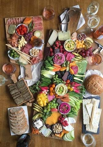 When serving a crudite platter and cheese board side by side, mix in elements from one into the other. Case in point? Set dipping bowls of mini cucumbers and tomatoes onto the cheese plate, and fresh fruit or slices of cheese onto the crudite platter. Conjoining these ingredients will impart a more cohesive feel to the overall look of the display.