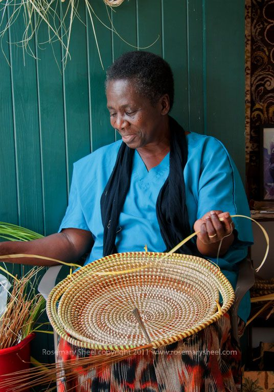 There is a 300 year old tradition of basket making among Gullah people in the coastal areas of South Carolina, Georgia and Florida. Gullah are the descendents of slaves brought from West Africa to work on the rice plantations. Originally the baskets were used to winnow the rice as well as for household use in the slave homes and maybe in the plantation owner's kitchen as well. The baskets feel as strong as steel. And it is said that they can be used to hold water. Rosemary Sheel photo