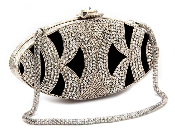 Prominent silver and black color clutch #Purse designed on velvet fabric and brass metal with sparkling diamantes and crystal. Item Code:SJBP2017B http://www.bharatplaza.com/new-arrivals/accessories.html