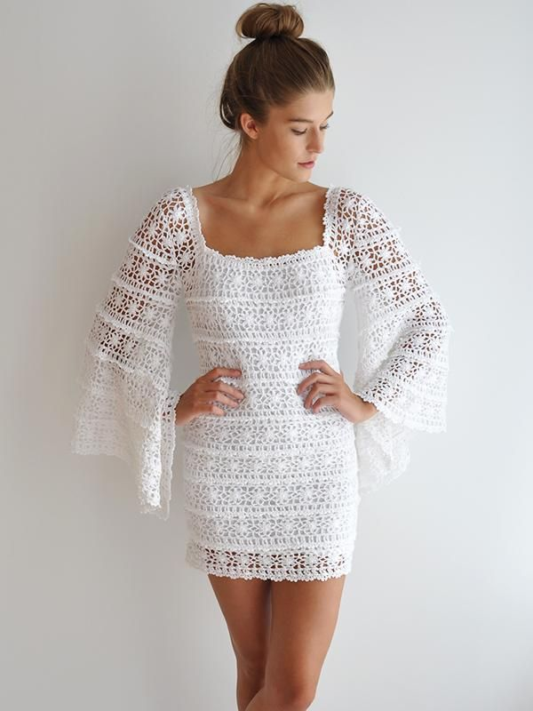Vintage lace inspired mini dress with long bell shaped sleeves. Pure romance. Removable Lining. 100% Cotton.