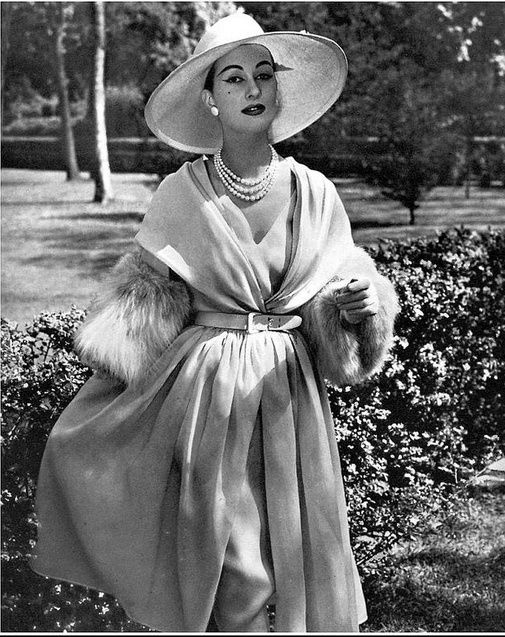 1957 Marina in sand colored chiffon wrap with lynx cuffs worn over chiffon dress, by Pierre Balmain
