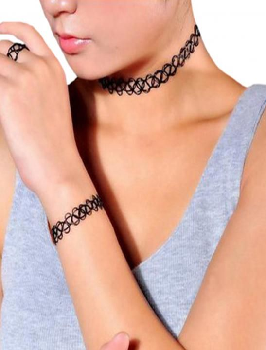 1990s style tattoo choker Stretch to fit over head fits comfortably around neck One size fits all.  Tattoo For Necklace, Bracelet, Ring, Arm, Anklet, Leg Looks amazing for all occassions, christmas, social meets, beach wears, parties & night outs.  As seen in the Sigala, Ella Eyre music video Came Here For Love.