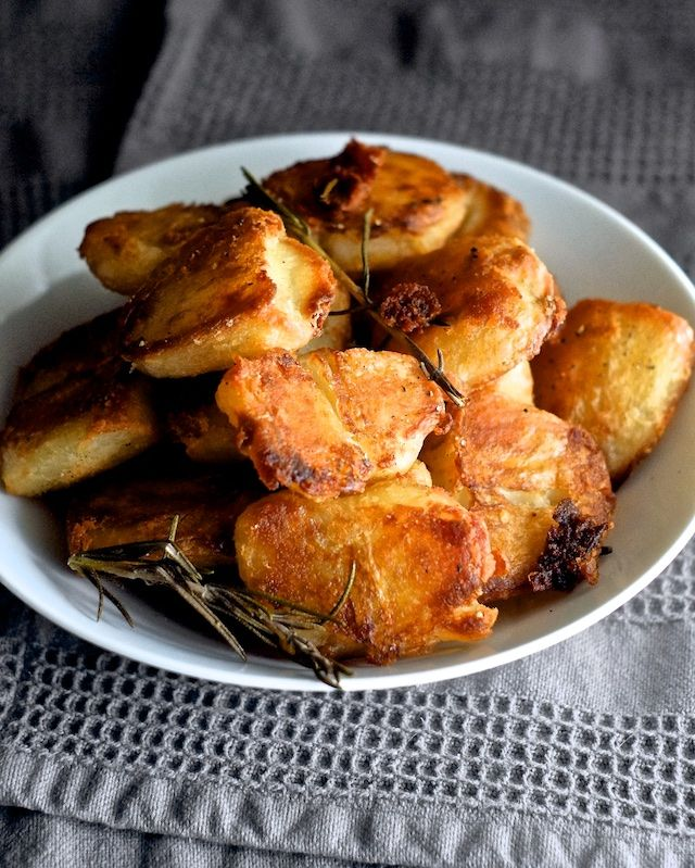 Crispy potatoes are my kryptonite. I live for spuds that crunch so loud I can't hear myself think, like twice-cooked Belgian frites, Utz ripple chips, and these English roasted potatoes. Cody lived in
