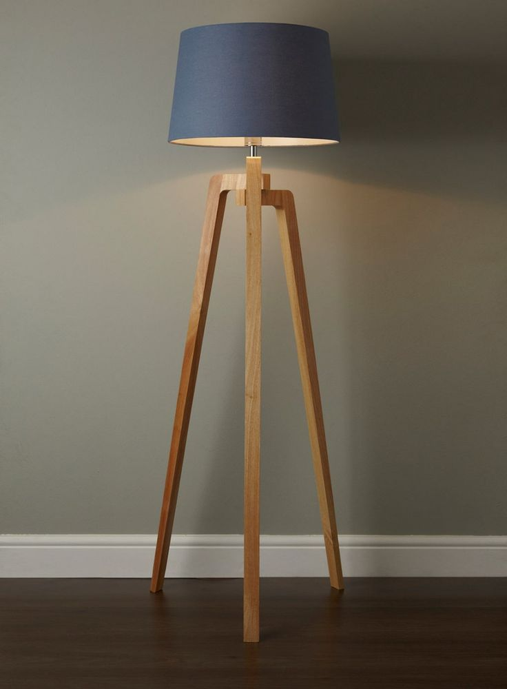 Delightful Unique Tripod Floor Lamp with Brown Wooden Tripod Legs and Stainless Steel Center Column