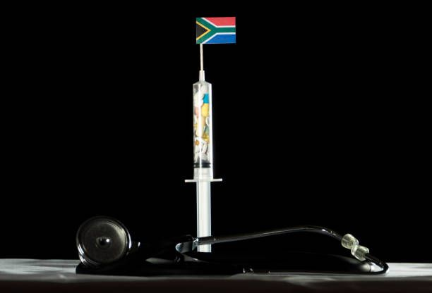 syringe filled with drugs injecting the south african flag