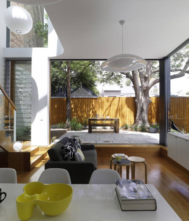 Here's a view from the kitchen looking through the opened sliding glass walls toward the backyard. Christopher Polly