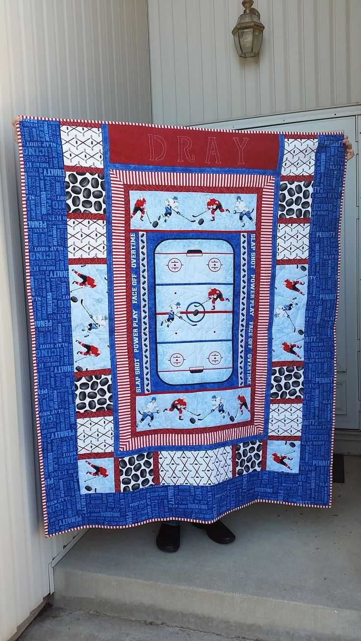 Hockey Quilt could do similar quilt for NASCAR maybe use T shirt blocks around the outside.