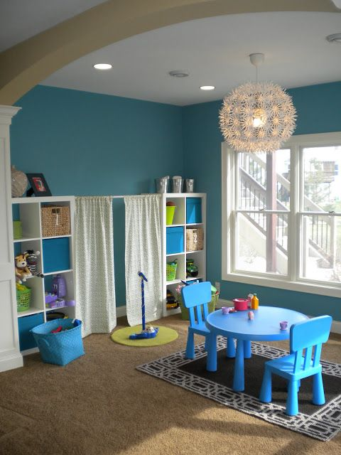 basement playroom-love the curtains between the shelves, as a stage.
