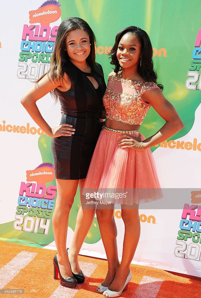 Olympic gymnast Gabby Douglas (R) and sister Arielle Douglas attend Nickelodeon Kids' Choice Sports Awards 2014 at Pauley Pavilion on July 17, 2014 in Los Angeles, California.