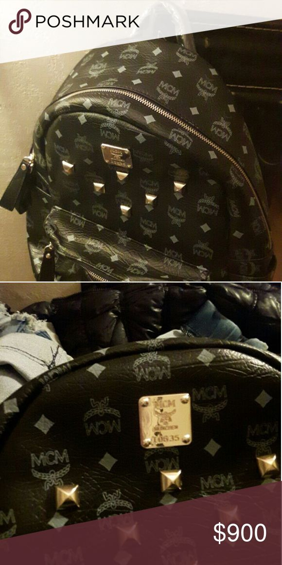 Mcm back pack Black with white mcm writing leather material numerous of pockets gold plated design gold zipper adjustable strap  comfortable  NOTE:no shipping  cash MCM Accessories