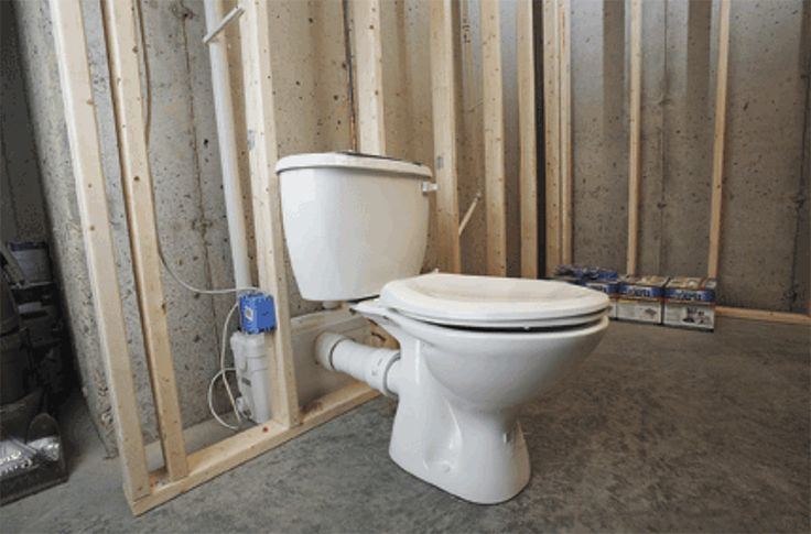 A Saniflo Upflush Toilet System Installed In A Basement
