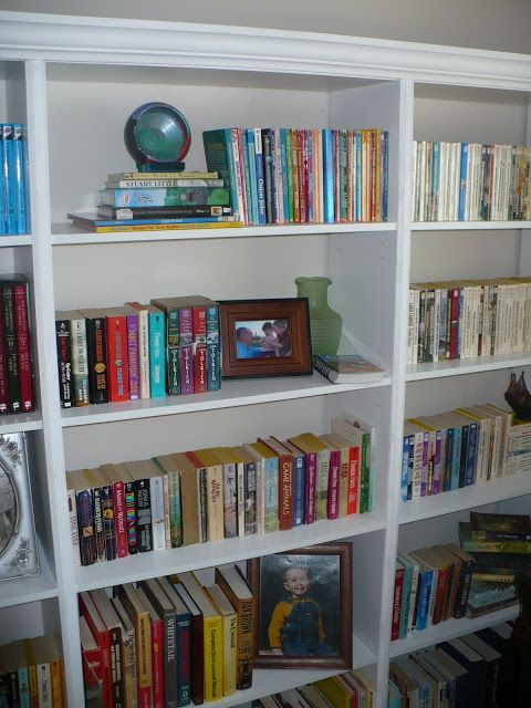 cheap bookshelves put together & made to look like built-ins