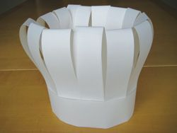 To make the chef's hat    You will need: roll of white paper; scissors; sticky tape.