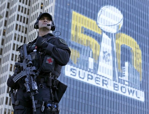 San Francisco Police tactical unit officer Jeff McHale watches the crowd at Super Bowl City Tuesday, Feb. 2, 2016 in San Francisco. From ticket scalpers to terrorism, football's biggest game always presents challenges large and small for law enforcement officials. Their task is made more difficult by the location of Super Bowl 50, some 45 miles fro
