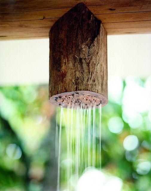 eucalyptus shower-head in open air bathroom of Estudio photo by Fernando Lombardi - Uxua Casa Hotel