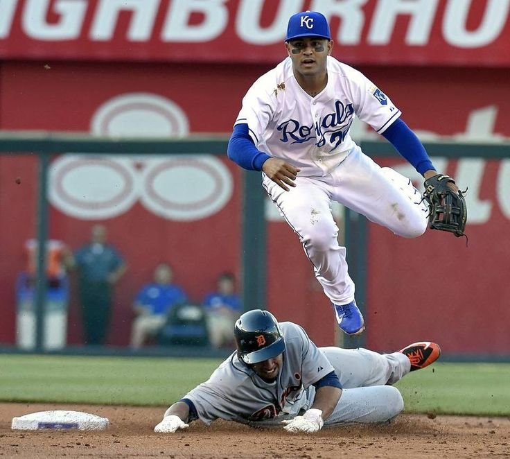 Kansas City Royals second baseman Christian Colon (24) forces out Detroit Tigers' Anthony Gose (12) at second, but Colon is charged with an error on the throw to first allowing Rajai Davis to score in the third inning during Saturday's baseball game on May 2, 2015 at Kauffman Stadium in Kansas City, Mo.