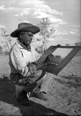 Portrait of Australian artist Albert Namatjira in Alice Springs, in 1958.  Indigenous Australian artist Albert Namatjira (1902–1959) is arguably Australia's best known Aboriginal painter. He is known for watercolours of desert landscapes rather than the symbolic style of traditional Aboriginal art. His paintings also depict Ghost Gums that were to be listed as heritage sites in Alice Springs, but these trees have now been burnt down.