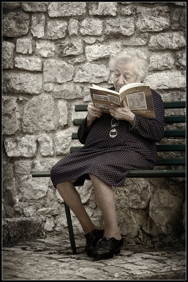 Never getting too old to read! Uhhhhh.....Yiayia...why are the glasses NOT on your face?