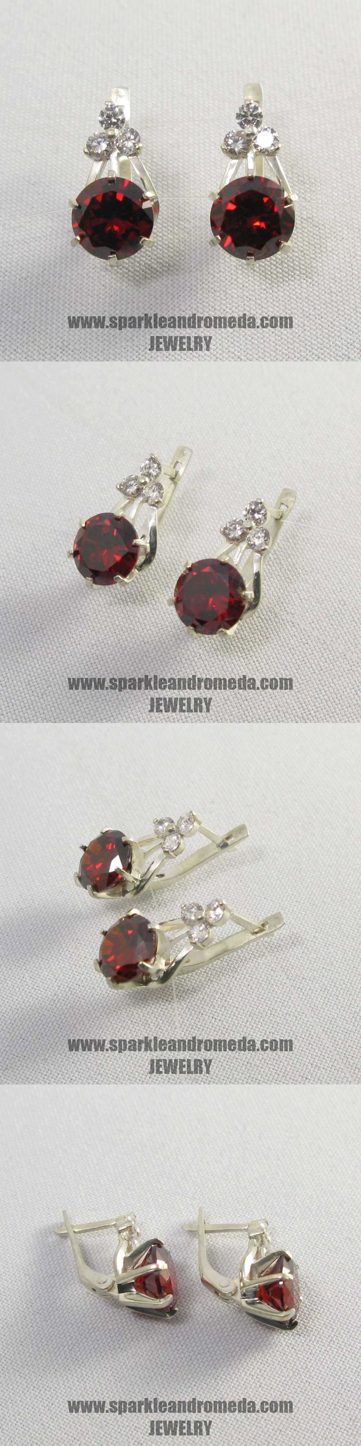 Sterling 925 silver earrings with 2 round 9 mm red almandine color and 6 round 3 mm white color cubic zirconia gemstones.