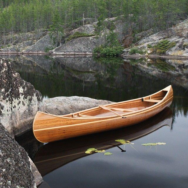 Cedar strip canoe on a trip to Nopiming Provincial Park. Photo by @rklassenartist. #exploremb