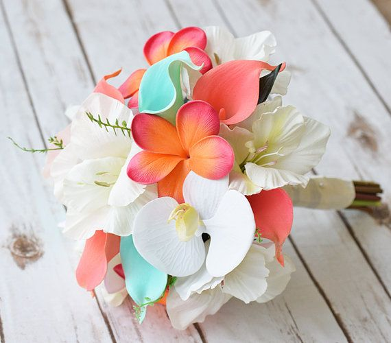 This is a beautiful -almost fresh- Off White, Coral Orange and Teal Turquoise Mint Mix of Orchids, Calla Lilies, Hibiscus and Plumerias Natural Touch