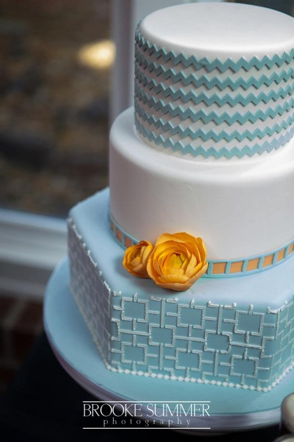 Not every layer of your cake has to be the same shape, and here's the proof! And, the style of this cake is not over the top girly! Both the bride and groom will like this one!